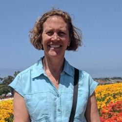 Photo of woman in flower field Ruth Struck's Open Strategies Northwest