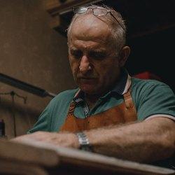 adult artisan artist wearing tan apron