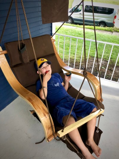 Anthony really enjoyed this swing on Noelle and Tom's porch