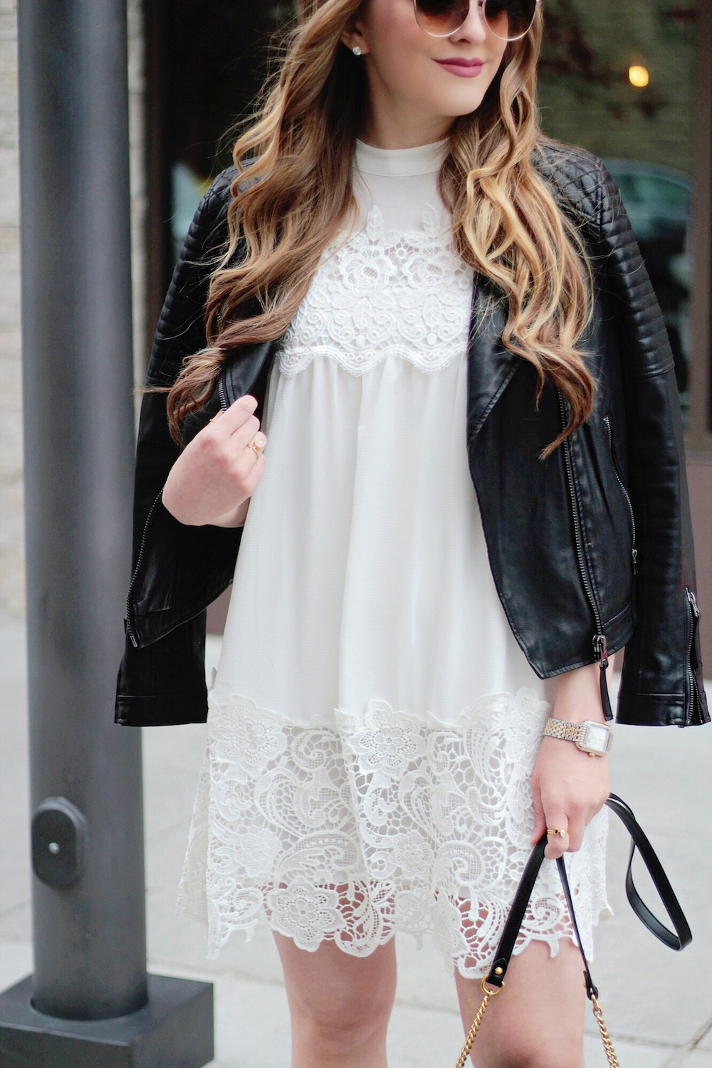 white dress and leather jacket rachel puccetti between two coasts