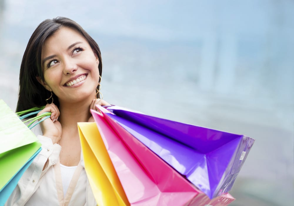 woman looking happy as she shops