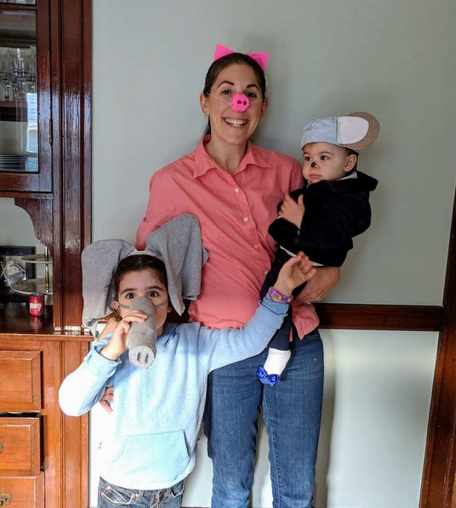 Mom with two young children dressed up in their DIY Halloween costumes