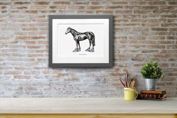 Print of a horse wearing bright coloured trainers in a grey frame on a red brick wall above a white shelf
