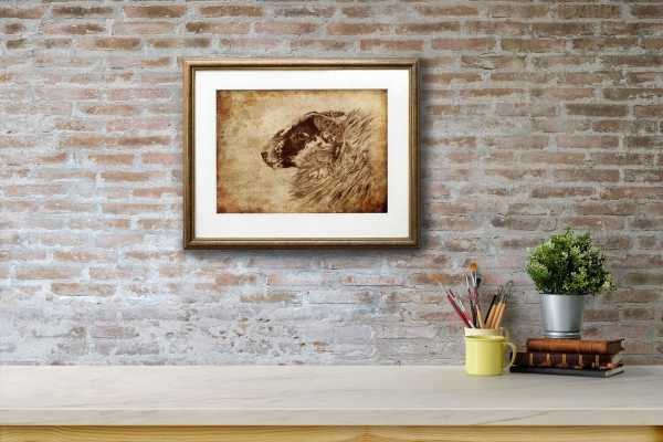 Print of a sheep's head on an aged textured background in a gold frame on a red brick wall above a white shelf