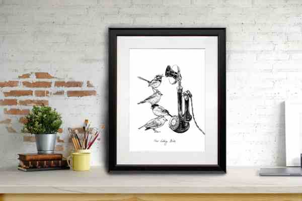 Print of four birds standing on top of each other next to a vintage telephone in a black frame leaning against a brick wall
