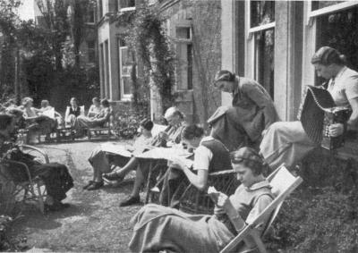 The girls relax in the college garden.