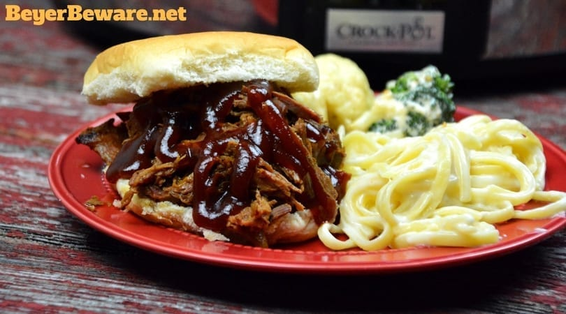This slow cooker root beer beef bbq recipe is the perfect combination of sweet and heat with a hint of smoke to leave your summer BBQ cravings satisfied.