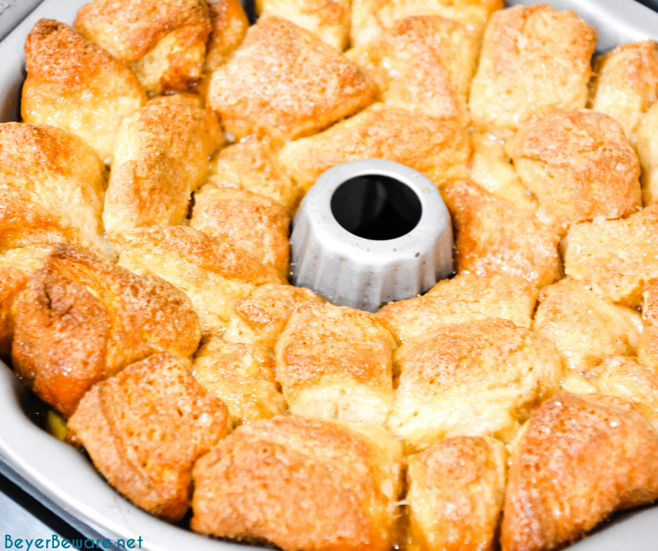 Monkey bread is a caramel pull-apart bread made with Grands biscuits, butter, sugar, and cinnamon then baked in a bundt cake pan for a gooey breakfast bread.