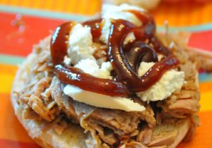 Crock Pot Dr. Pepper Pulled Pork with cheese and BBQ sauce