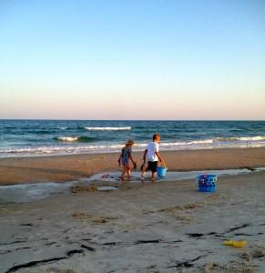 kids walking on the beach