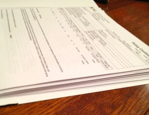 stack of papers that is the crop insurance policy