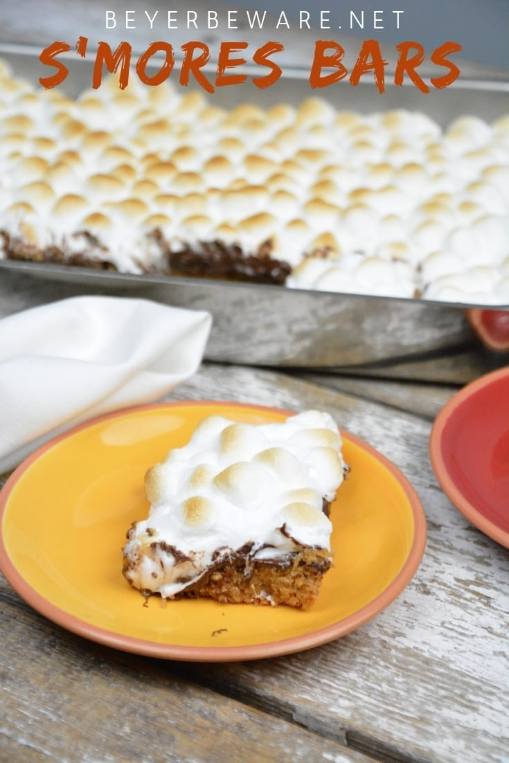 S'mores bars are an easy fall baked treat for the s'mores lovers. Five simple ingredients of sugar cookie dough, graham cracker crumbs, butter, chocolate, and marshmallows will be baked in less than 30 minutes make the perfect fall dessert. #FallTreats #FallRecipes #Smores #Bars #Recipes
