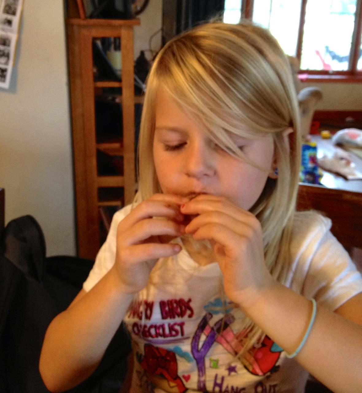 girl eating ribs