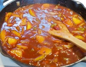 simmering apples and veggies for pork ragu braise