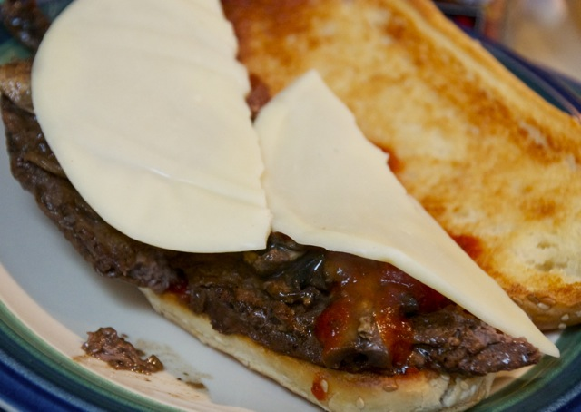Cheese covered steak sandwich