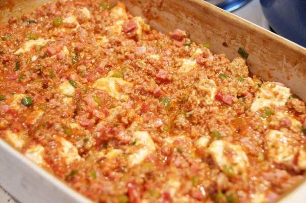 Bubble Pizza Casserole spread into pan