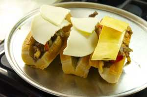 cheese topped steak sandwiches