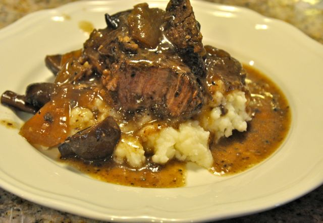 Slow Cooked beef roast and mushrooms in red wine