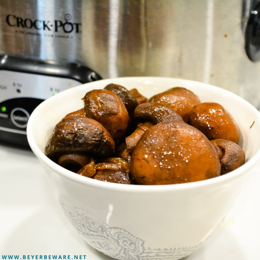 Crock pot mushrooms and onions with red wine, butter and garlic make an incredible low-carb side dish after slow cooking for 12 hours.