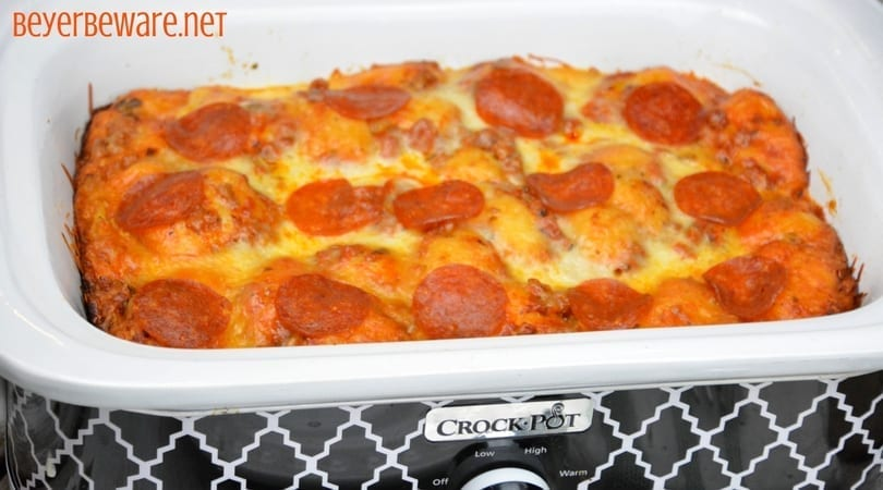 After three hours this crock pot bubble up pizza casserole was a cheesy goodness filled with our favorite pizza toppings. It is the perfect way to make a weeknight meal when you can't be home to put the casserole in the oven.