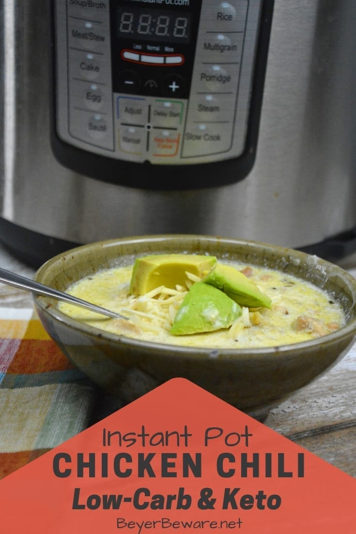 Low-Carb Instant Pot Chicken Chili is low on carbs but high in fat and flavor with tender pieces of chicken given rich flavors from better than bouillion, garlic and onions, and lots of adobo seasoning. Plus with riced cauliflower, you don't even miss the beans either. #Keto #KetoSoup #LowCarb #LowcarbSoup #ChickenChili