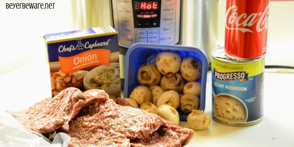 Instant Pot Cola Cubed Beef Steaks is a simple recipe made quickly with the dump of cubed steaks, a Coke, onion soup mix and cream of mushroom soup in the Instant Pot. #InstantPot #Beef