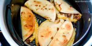 Air Fryer Mini Beef Tacos in the Ninja Foodi is an easy fried taco recipe made with taco seasoned hamburger, cheese and flour or corn tortilla shells. #Tacos #Airfryer #NinjaFoodi #Beef