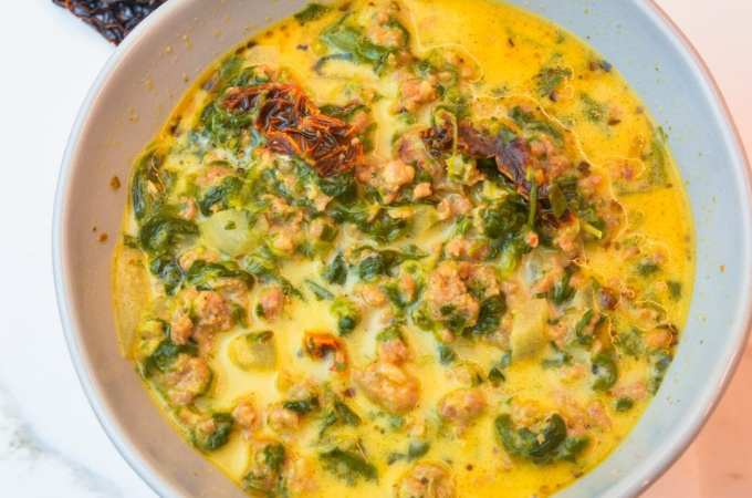 Keto Tuscan sausage soup is a creamy spicy sausage soup with plenty of spinach, sun-dried tomatoes, and spice for an easy and satisfying low-carb soup.