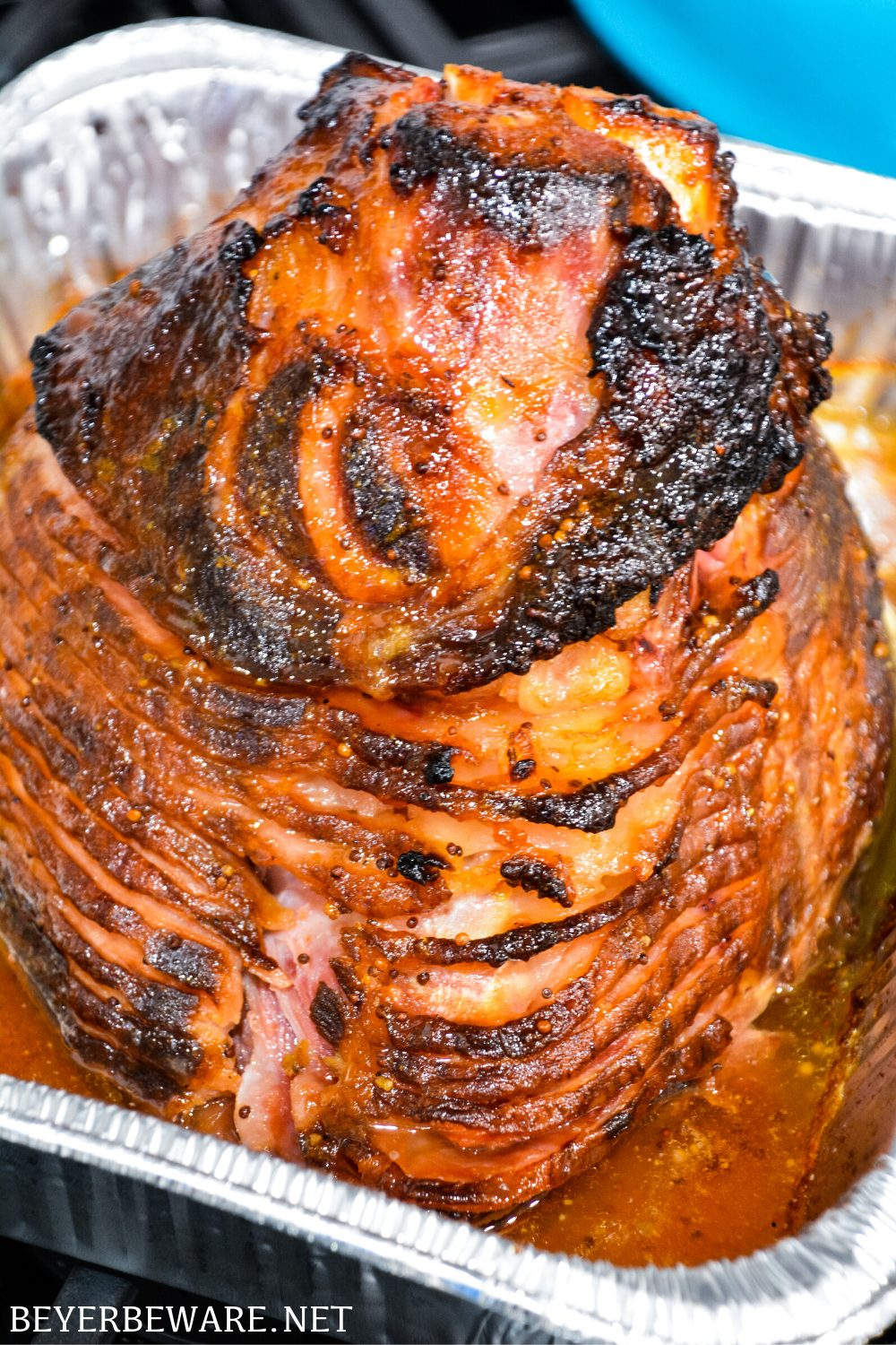 Apricot bourbon-glazed ham on the grill is a sweet and salty combination of flavors with apricot jam, mustard, maple syrup, lemon juice, and bourbon and then smoke drenched on the Big Green Egg.