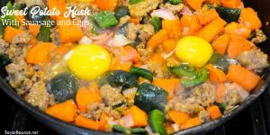 Season the sweet potato hash skillet with salt, pepper, and some ground sage. Stir and continue to cook until the potatoes are soft. Then over the sweet potatoes, sausage, onions, and poblano peppers crack the eggs.