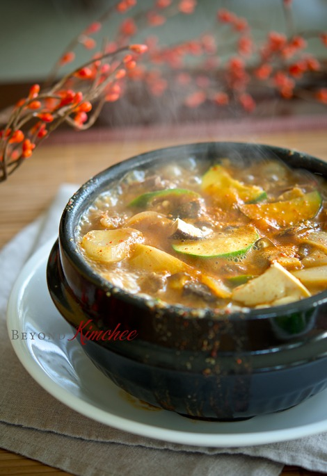Beef donajng jjigae is boiling in a Korean stone pot