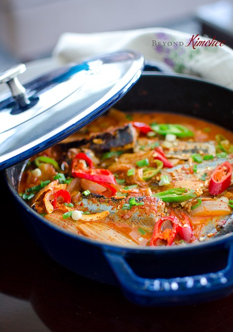 A large pot of red and spicy Korean mackerel pike kimchi jjigae.