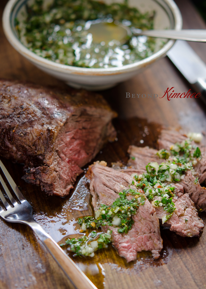 Beef steak is drizzled with Argentine chimichurri sauce