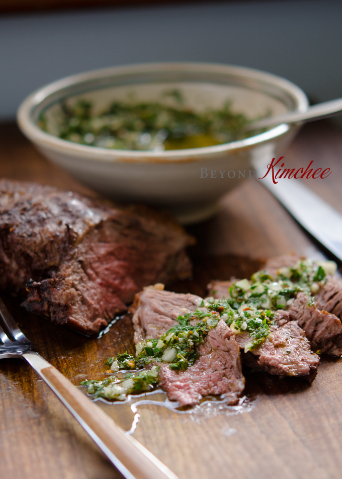 Serving beef steak with chimichurri sauce