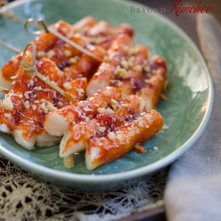 Rice Cake Skewers are brushed with Korean chili paste sauce