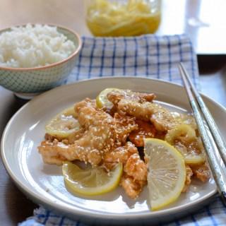 Crispy Lemon Chicken is plated with slices of fresh lemon