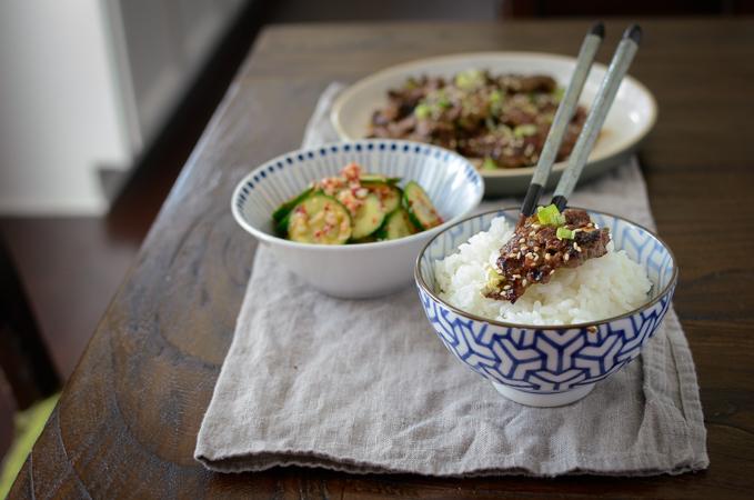 Serve Korean crispy beef with rice and cucumber salad.