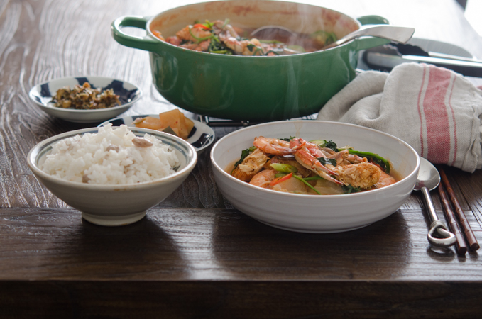 Serve Korean crab stew with rice and side dishes.
