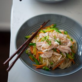 One Pot Korean Noodles and Vegetables are topped with slices of lunch ham