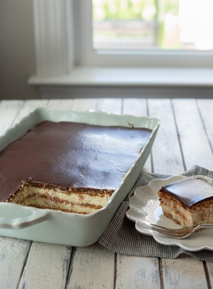 No-bake eclair cake made from scratch with graham crackers, vanilla custard, and chocolate ganache.