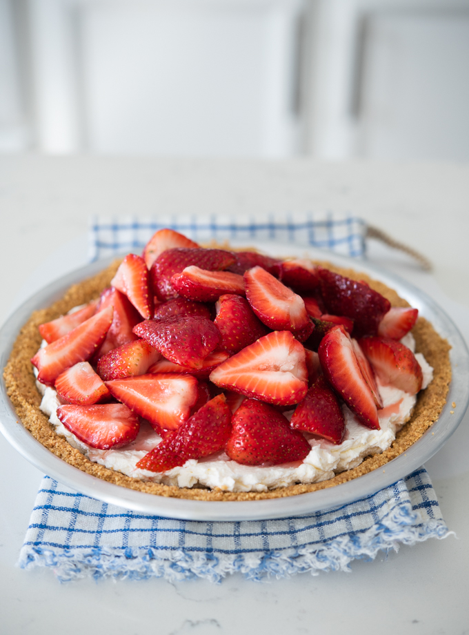 Fresh strawberry pie made with creamy mascarpone cheese filling and graham cookie crust