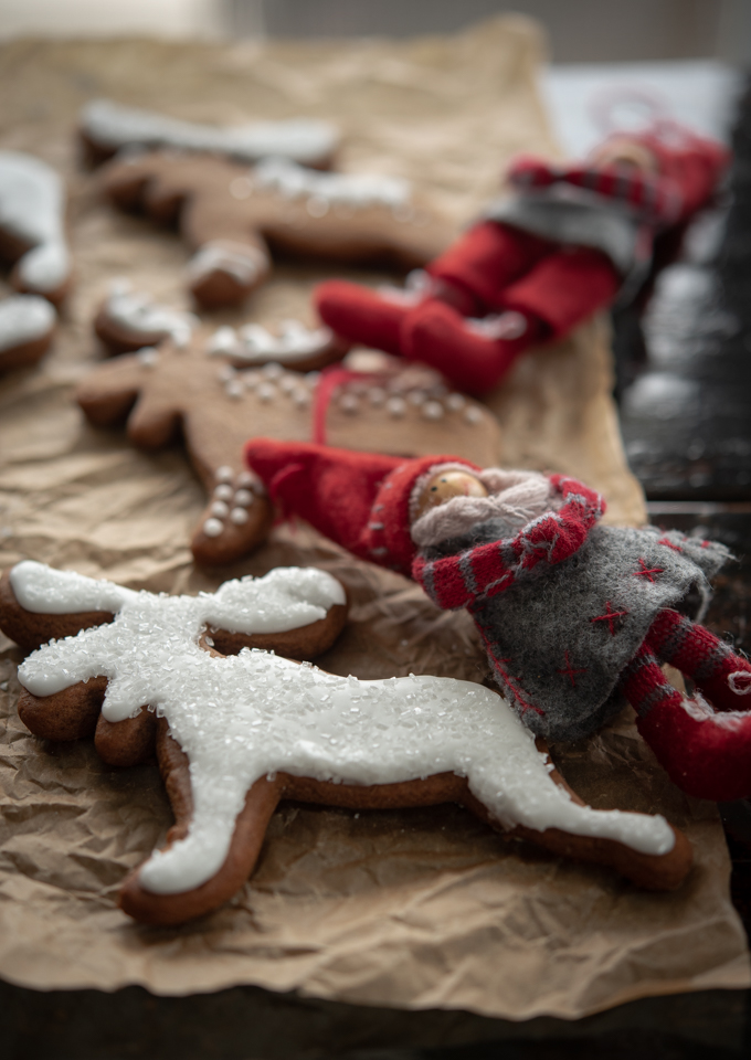 Scandinavian ginger cookies are decorated with simple white icing and sparkling sugar