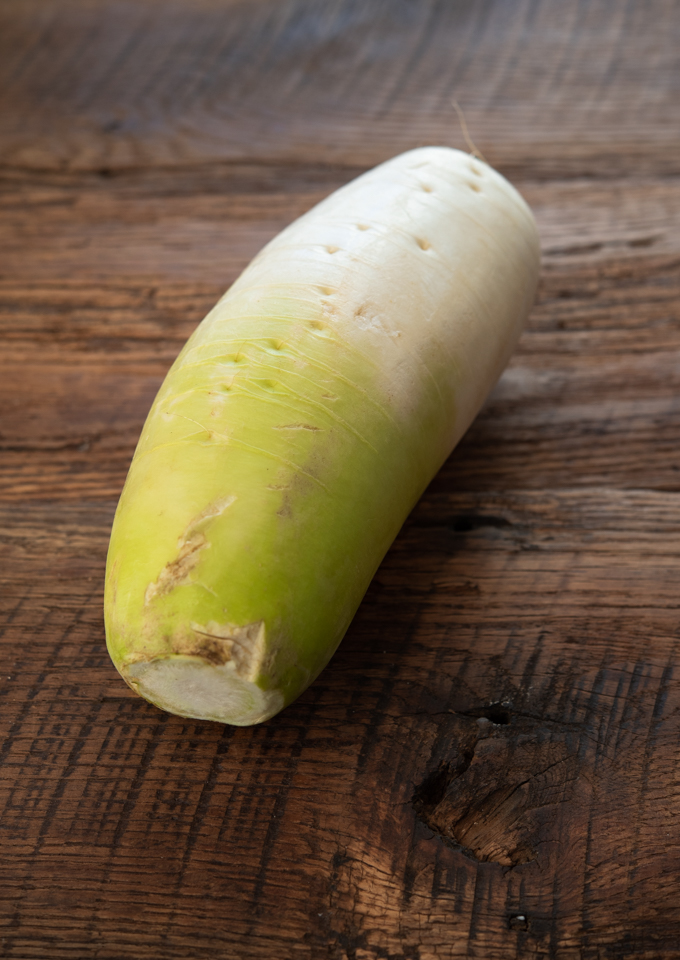 Korean radish is rounder and has a green hues toward the stem
