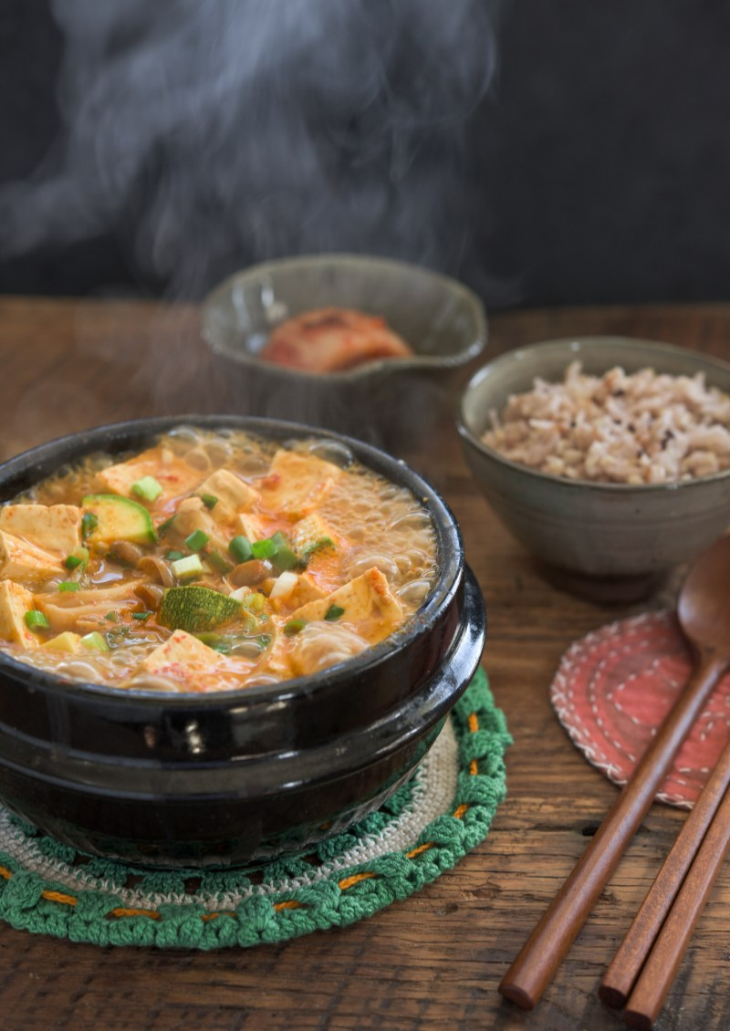 Hot boiling doenjang jjigae is a served with rice and kimchi