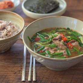 This Korean soybean paste soup is made with beef, watercress and chives