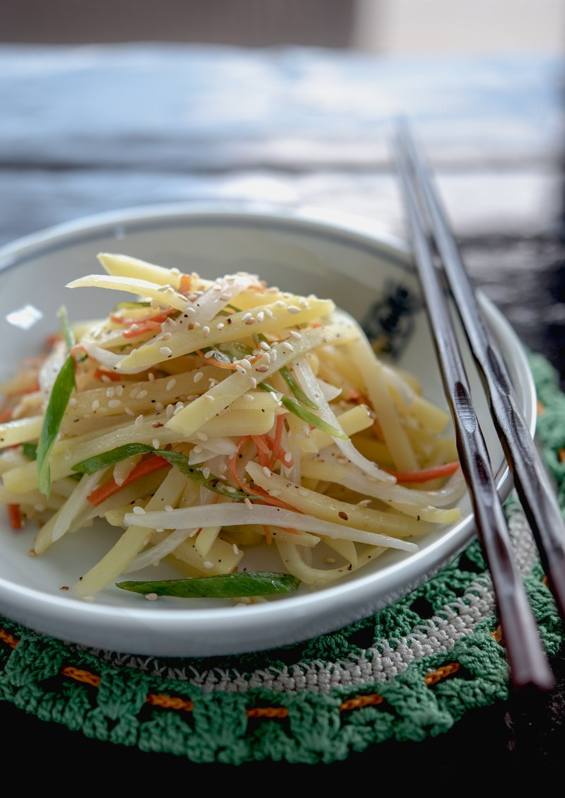 Korean pan-fried Potato side dish is made with strips of potato and vegetables