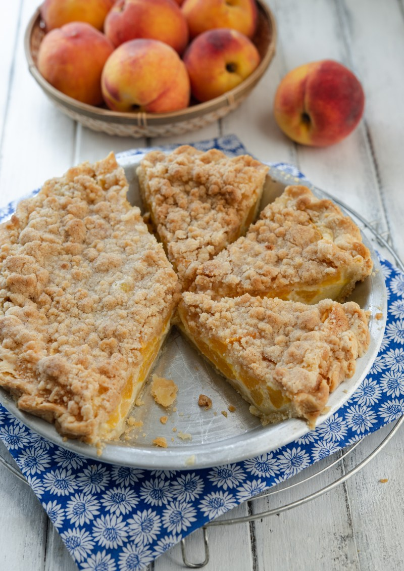 Fresh peach, custard, and streusel combination makes a exceptionally delicious pie.
