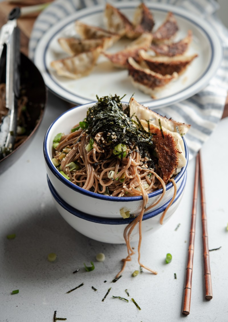 Quick sesame soba noodles are topped with crumbled seaweed and fried dumplings