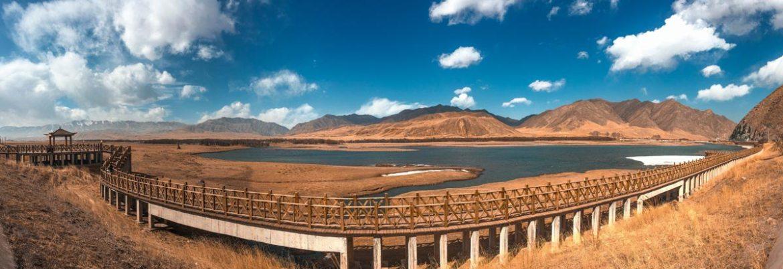 sanko-grassland-gansu-with-bridge-and-lake-view