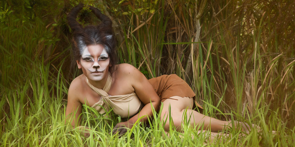 Hawaii Conceptual Portrait woman dressed as gazelle laying in grass